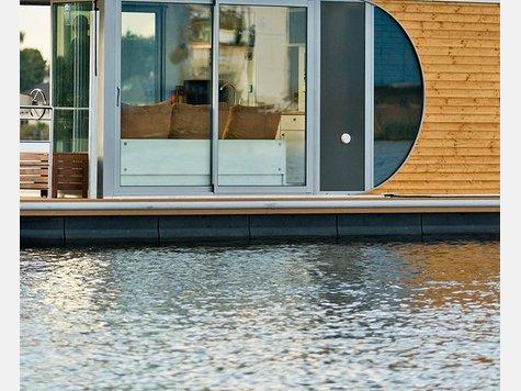 kaffee kette tchibo verkauft jetzt auch hausboote wirtschaft. Black Bedroom Furniture Sets. Home Design Ideas